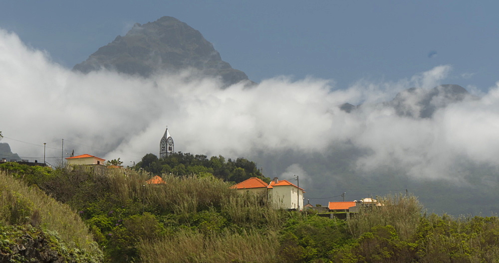 View of clouds surrounding local hilltop church at Sao Vicente, Madeira, Portugal, Atlantic, Europe
