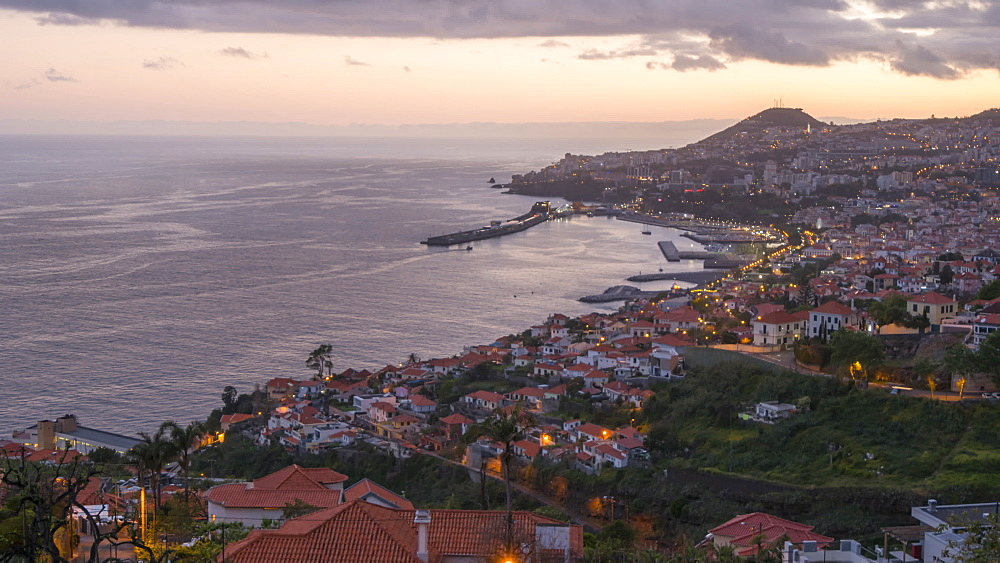 Elevated view of town and harbour at dusk, Funchal, Madeira, Portugal, Atlantic, Europe