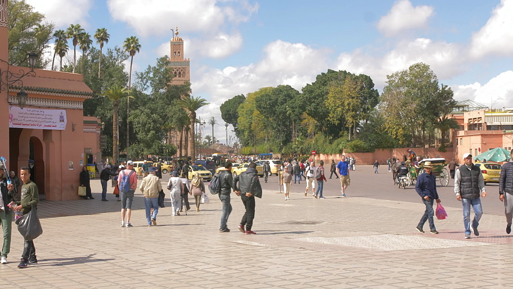 Tourists and activity on Djemaa el Fna showing Koutoubia Minaret, Marrakech, Morocco, North Africa, Africa