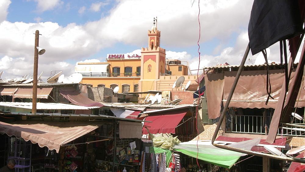 Zoom shot over rooftops on market Djemaa el Fna and minaret, Marrakech, Morocco, North Africa, Africa - 844-16692