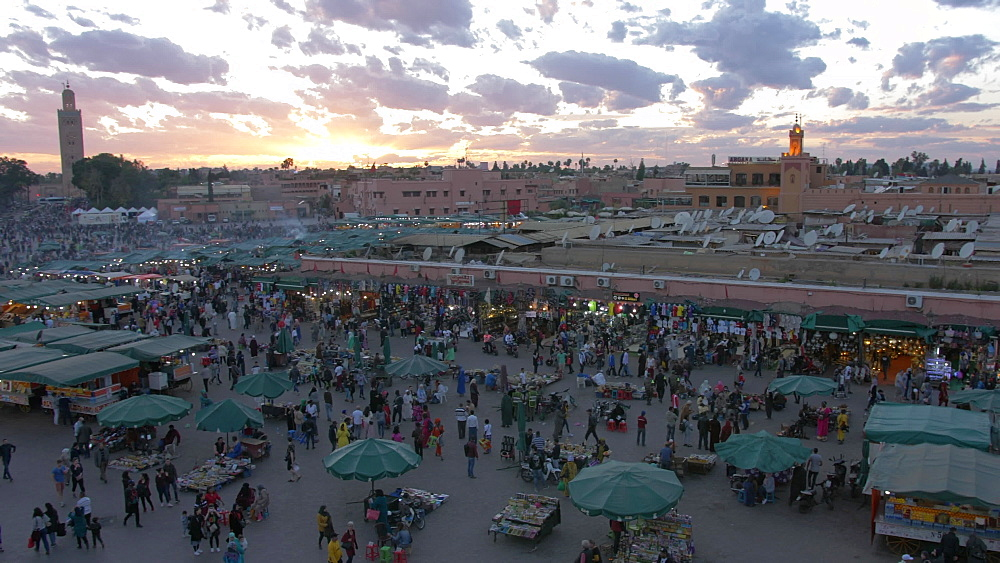 Activity on Djemaa el Fna from cafe bar at sunset, UNESCO World Heritage Site, Marrakech, Morocco, North Africa, Africa