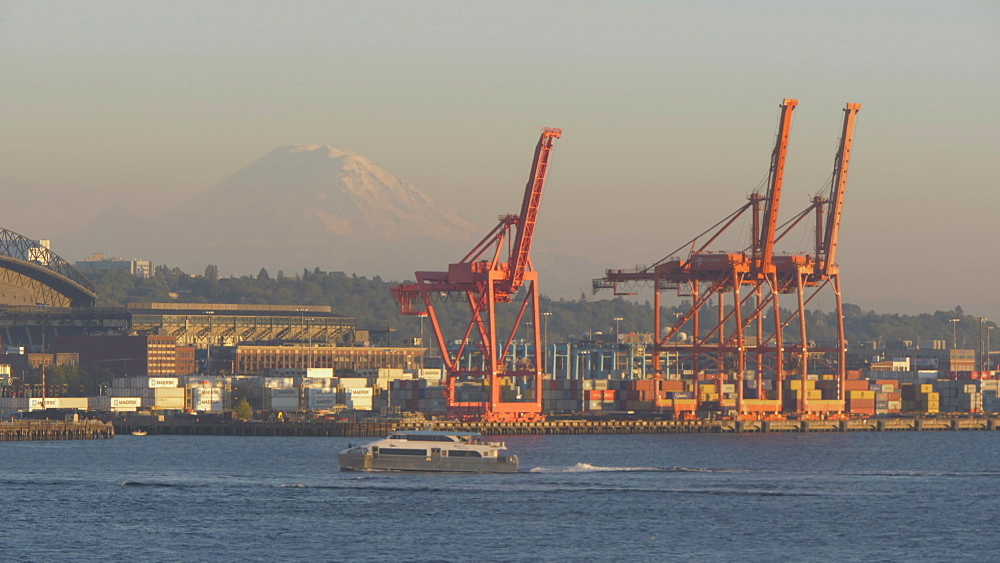 View of Dockland cranes and Cougar Mountain visible in background, Seattle, Washington State, United States of America, North America