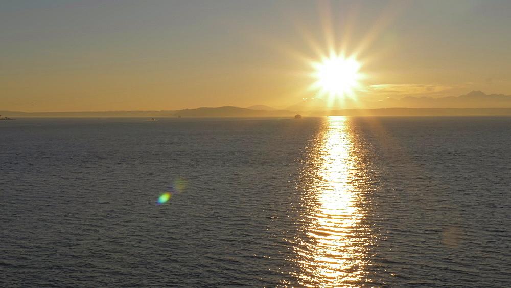 View of Bainbridge Ferry crossing Elliott Bay at sunset, Seattle, Washington State, United States of America, North America