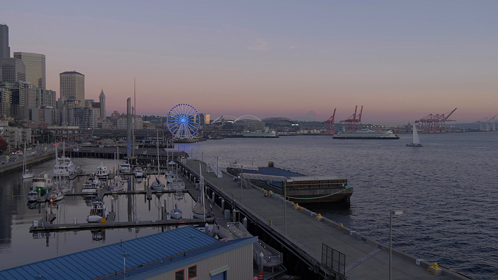 Seattle Downtown, including Seattle Wheel and waterfront at dusk, Seattle, Washington State, United States of America, North America