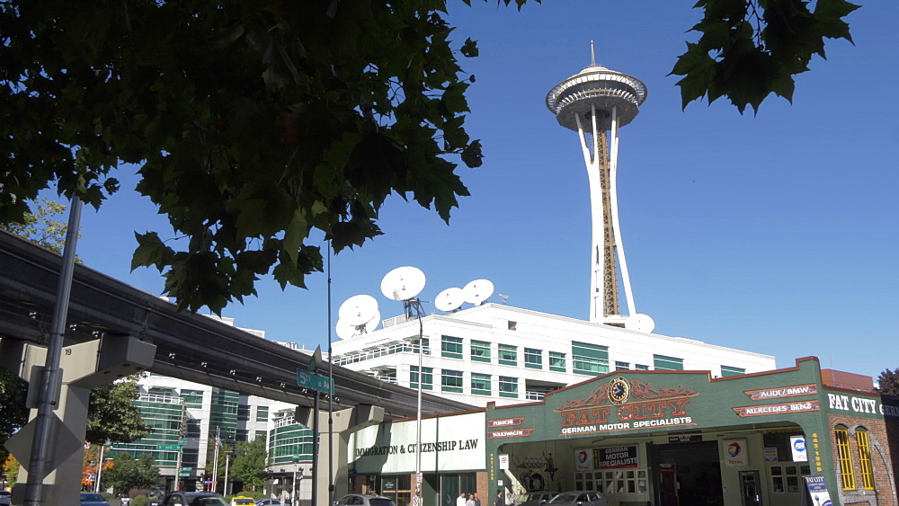 Following shot of Monorail train and Space Needle, Seattle, Washington State, United States of America, North America - 844-16806