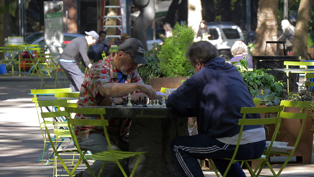 Two locals playing chess in Occidental Square, Pioneer Square District, Seattle, Washington State, United States of America, North America