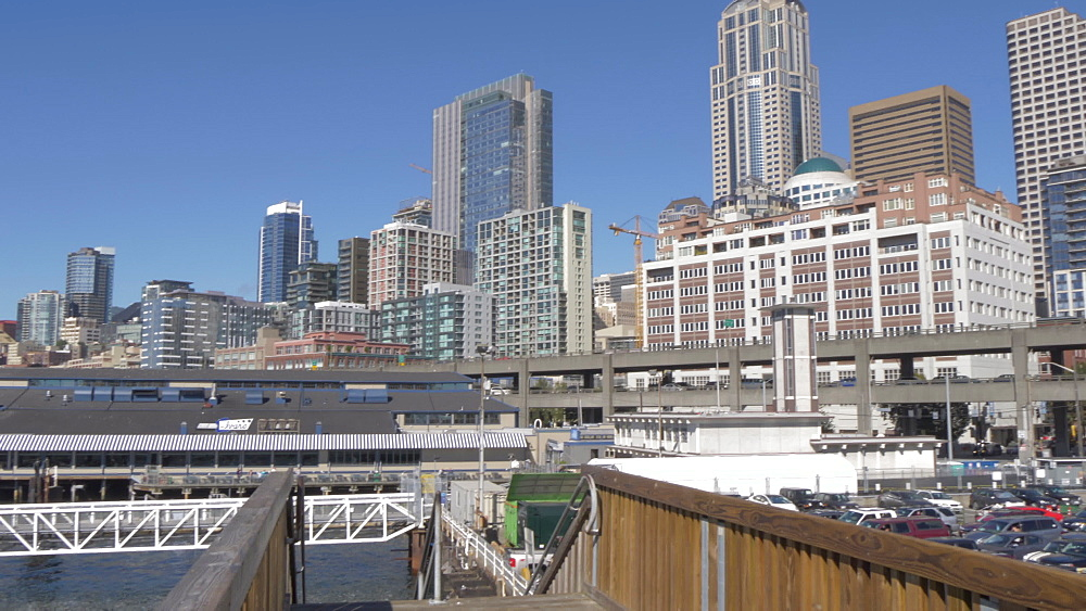 View of Bainbridge-Seattle Ferry unloading at Colman Dock Ferry Terminal & Downtown, Seattle, Washington State, United States of America, North America - 844-16825