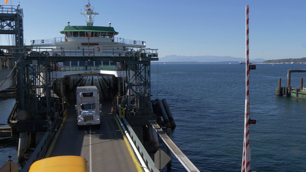 View of Bainbridge-Seattle Ferry unloading at Colman Dock Ferry Terminal & Downtown, Seattle, Washington State, United States of America, North America - 844-16826
