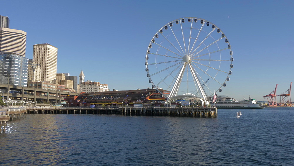 Panning view of Seattle Great Wheel and Downtown from Elliott Bay, Seattle, Washington State, United States of America, North America - 844-16831