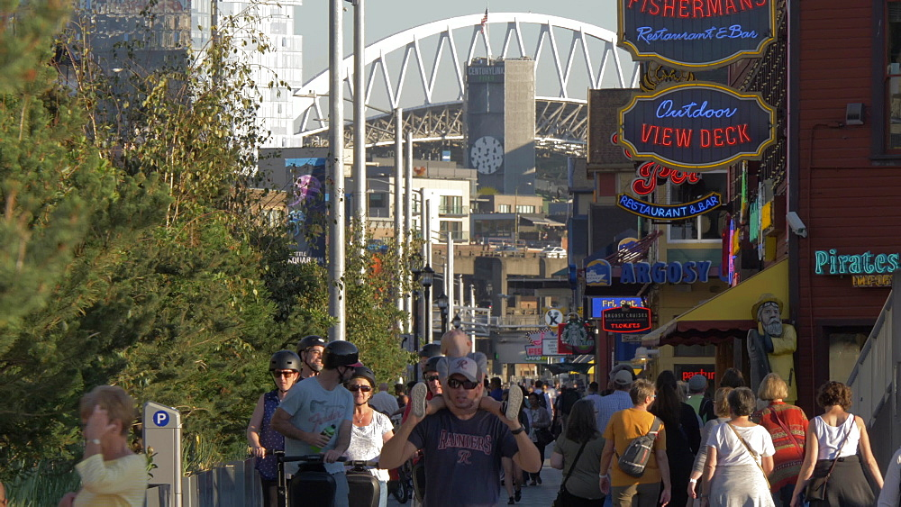 View of Piers and people along Alaskan Way towards CenturyLink Fields, Seattle, Washington State, United States of America, North America - 844-16834