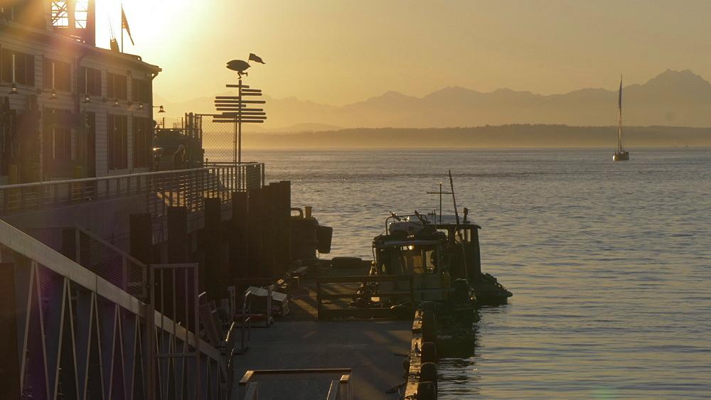 View of Pier, Bainbridge Island and Elliott Bay at sunset, Seattle, Washington State, United States of America, North America - 844-16837