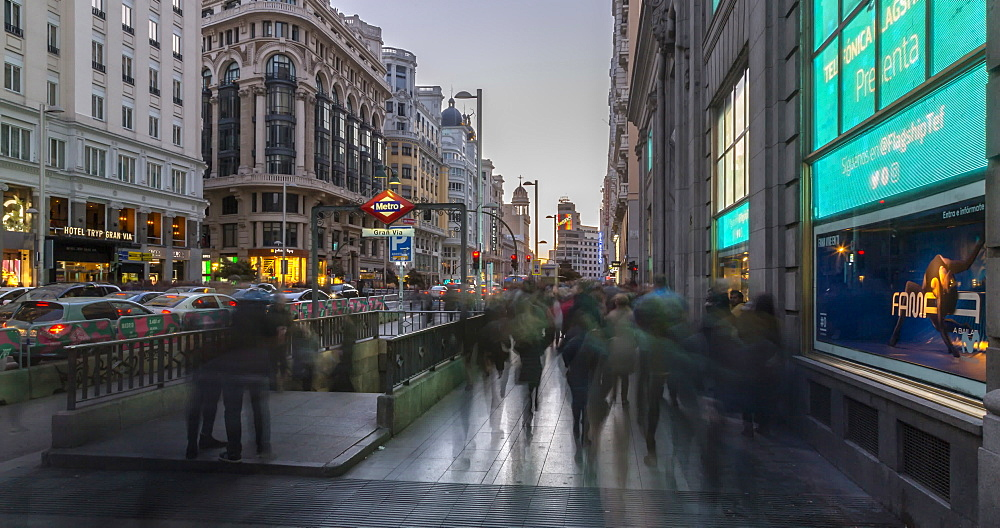 Time lapse of people and neon lights on Gran Via at dusk, Madrid, Spain, Europe