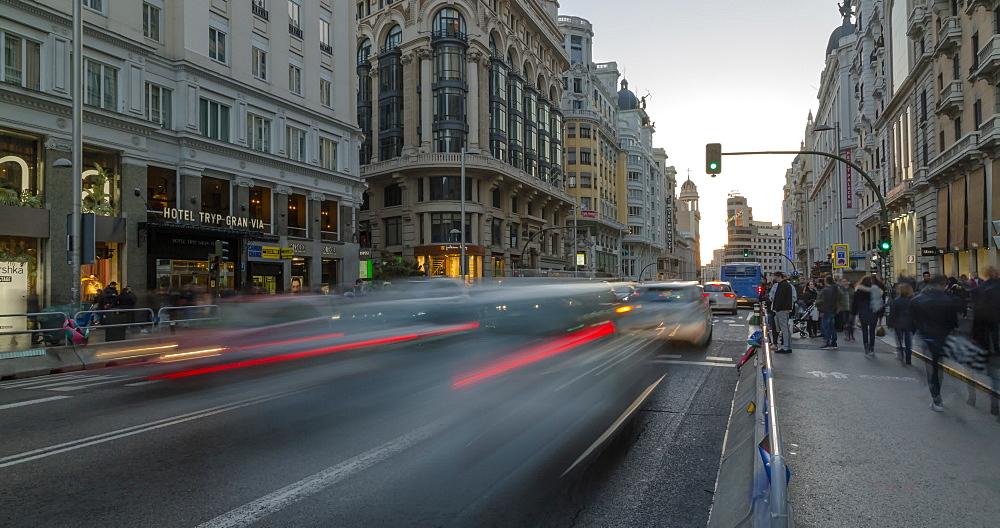 Time lapse of people and traffic on Gran Via at dusk, Madrid, Spain, Europe - 844-16885