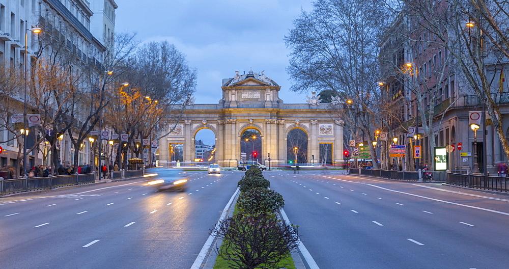 Time lapse of Triomphal Arch (Puerta de Alcala) in Plaza de la Independancia, at dusk, Madrid, Spain, Europe