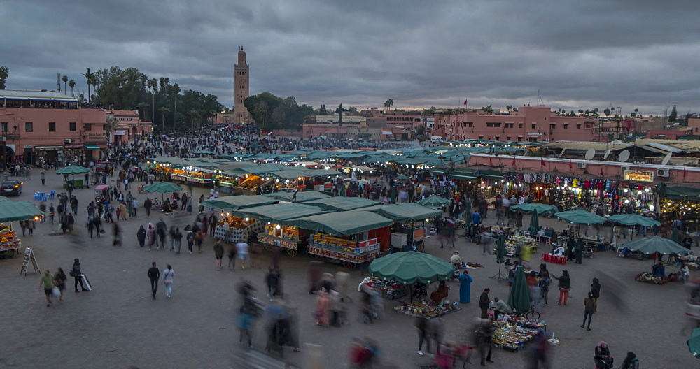Time lapse of Jemaa el Fna (Djemaa el Fnaa) Square, UNESCO World Heritage Site, at dusk, Marrakesh, Morocco, North Africa, Africa
