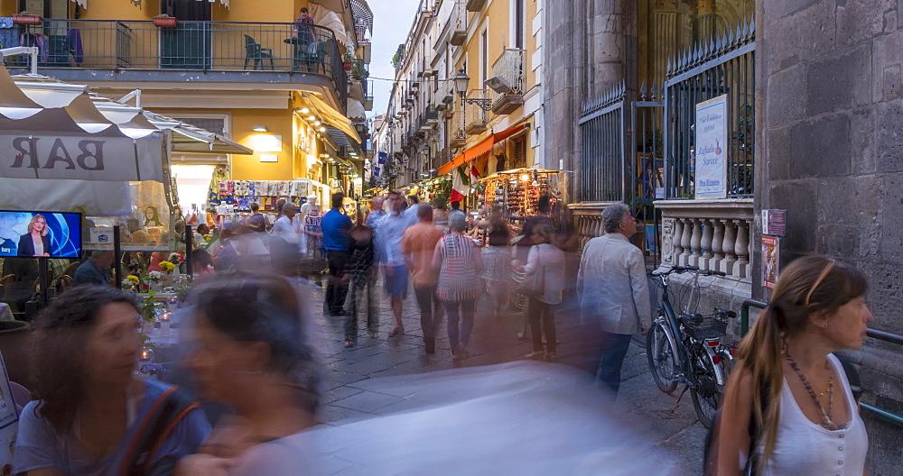 Time lapse of restaurant and shoppers on Via San Cesareo at dusk, Sorrento, Campania, Amalfi Coast, Italy, Europe