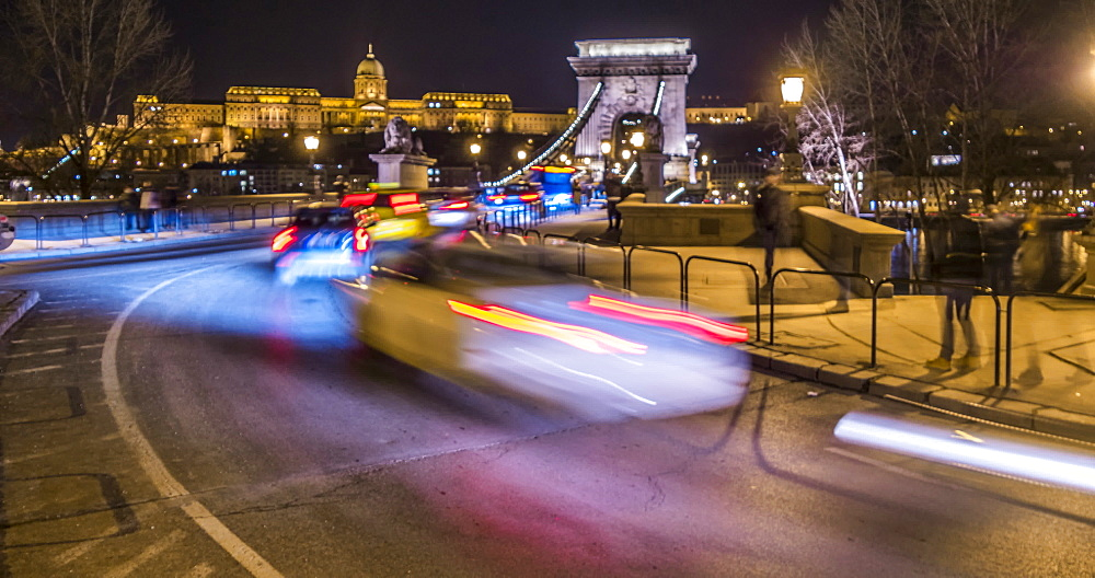 Time lapse of traffic on Chain Bridge and Budapest Castle at night in winter, UNESCO World Heritage Site, Budapest, Hungary, Europe