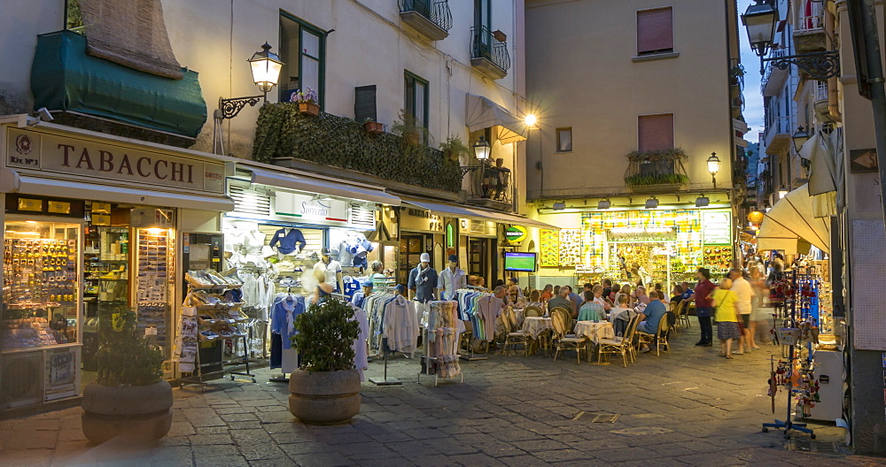 Time lapse of restaurant and shoppers on Via San Cesareo at dusk, Sorrento, Campania, Amalfi Coast, Italy, Europe