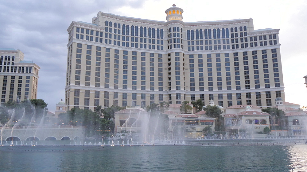 View of the Bellagio Hotel and Casino fountains at dusk on The Strip, Las Vegas Boulevard, Las Vegas, Nevada, United States of America, North America