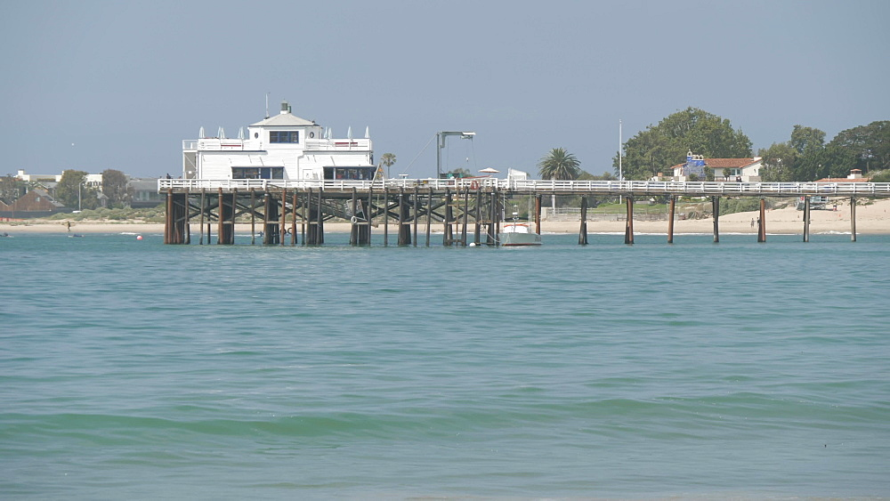 View of waves and Malibu Pier on sunny day, Los Angeles, California, United States of America, North America