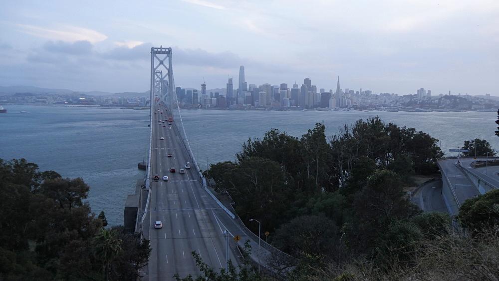 View of Oakland Bay Bridge and city skyline from Yerba Buena Island at dusk, San Francisco, California, United States of America, North America
