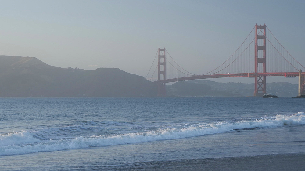 View over Baker Beach towards Golden Gate Bridge at sunset, South Bay, San Francisco, California, United States of America, North America - 844-17510
