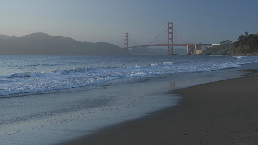 View over Baker Beach towards Golden Gate Bridge at sunset, South Bay, San Francisco, California, United States of America, North America
