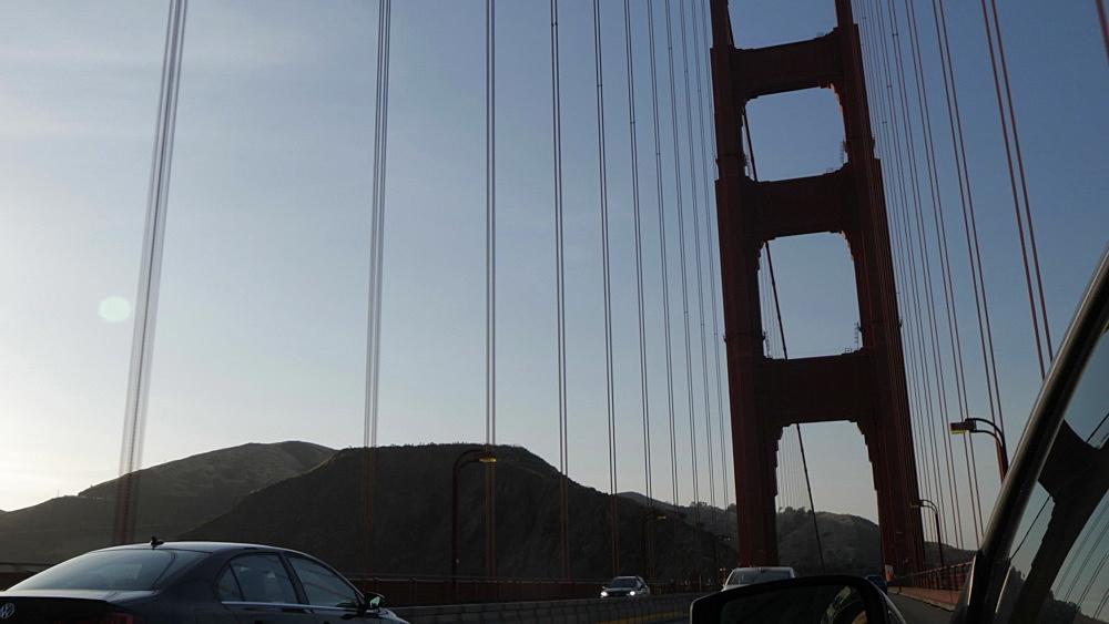 Travelling across Golden Gate Bridge at sunset, San Francisco, California, United States of America, North America - 844-17543
