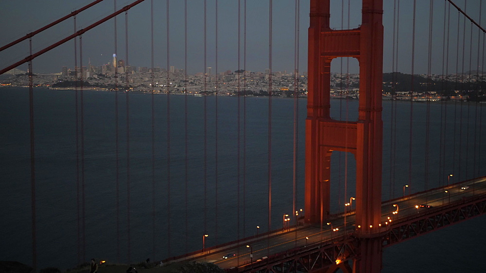 The Golden Gate Bridge and city in background at dusk, San Francisco, California, United States of America, North America