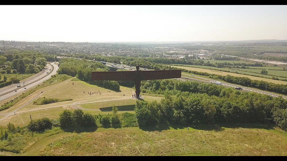 Flight above Angel of the North sculpture by Antony Gormley, Gateshead, Newcastle-upon-Tyne, Tyne and Wear, England, United Kingdom, Europe