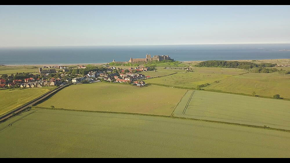 Aerial view of Bamburgh Castle with North Sea in background, Northumberland, England, United Kingdom, Europe