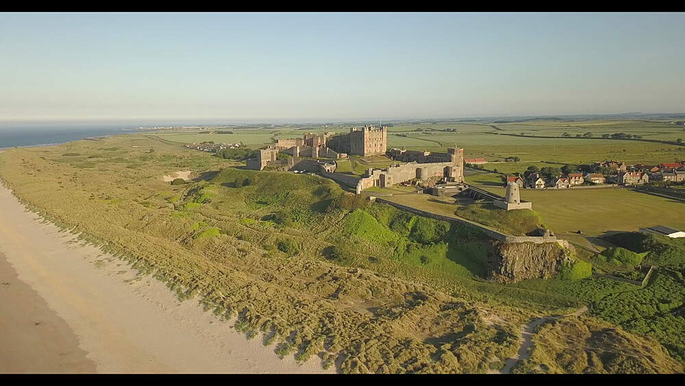 Aerial view Bamburgh Castle from beach, Northumberland, England, United Kingdom, Europe