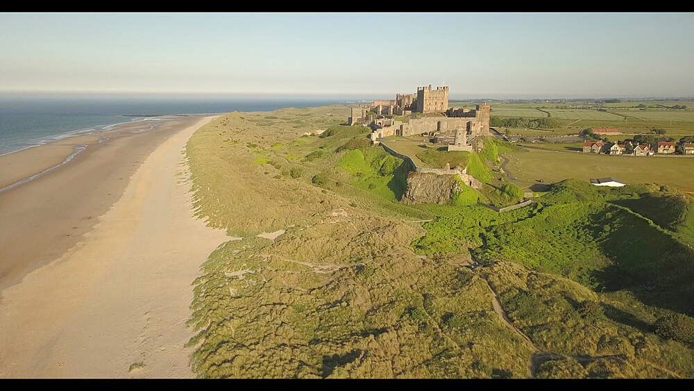 Aerial view of Bamburgh Castle and beach, Northumberland, England, United Kingdom, Europe