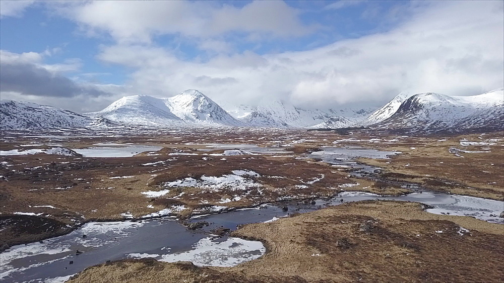 Aerial view looking towards mountains and frozen water near Bridge of Orchy, Highlands, Argyll and Bute, Scotland, United Kingdom, Europe