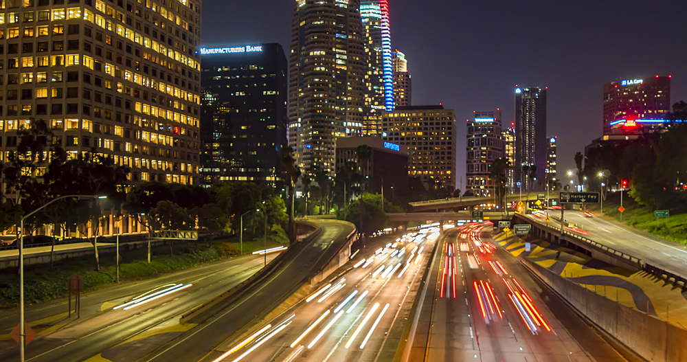 Time lapse of 110 Freeway through Downtown Financial District at night, Los Angeles, California, USA, North America - 844-18059