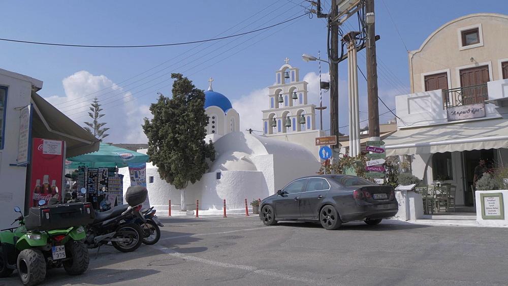 Panning shot of main street in Akrotiri toward St. Epifanios Traditional Orthodox Church, Santorini, Greek Islands, Greece, Europe - 844-18087