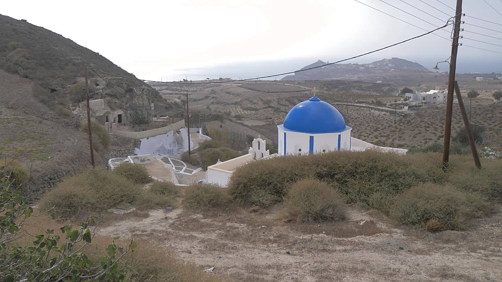 View of traditional blue domed church near Akrotiri, Santorini, Greek Islands, Greece, Europe - 844-18099