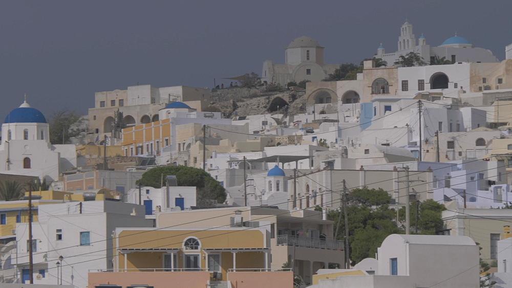 Panning shot of hilltop village of Pyrgos Kallistis, Santorini, Greek Islands, Greece, Europe - 844-18102