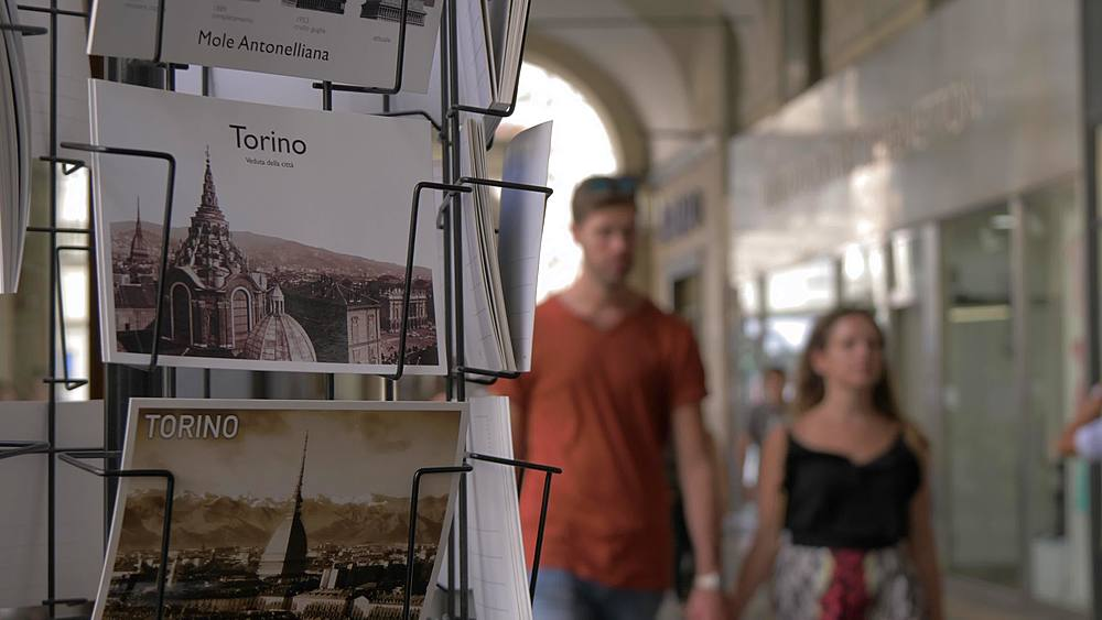 Slider shot of postcards and out of focus people, Turin, Piedmont, Italy, Europe