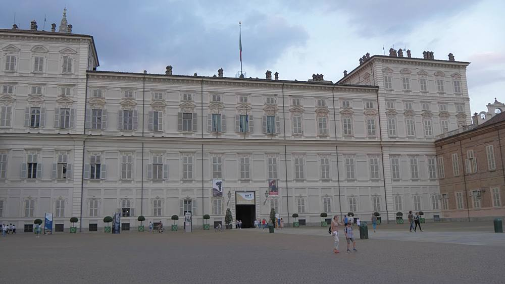 Pan shot of Palazzo Reale di Torino in Piazzetta Reale, Turin, Piedmont, Italy, Europe