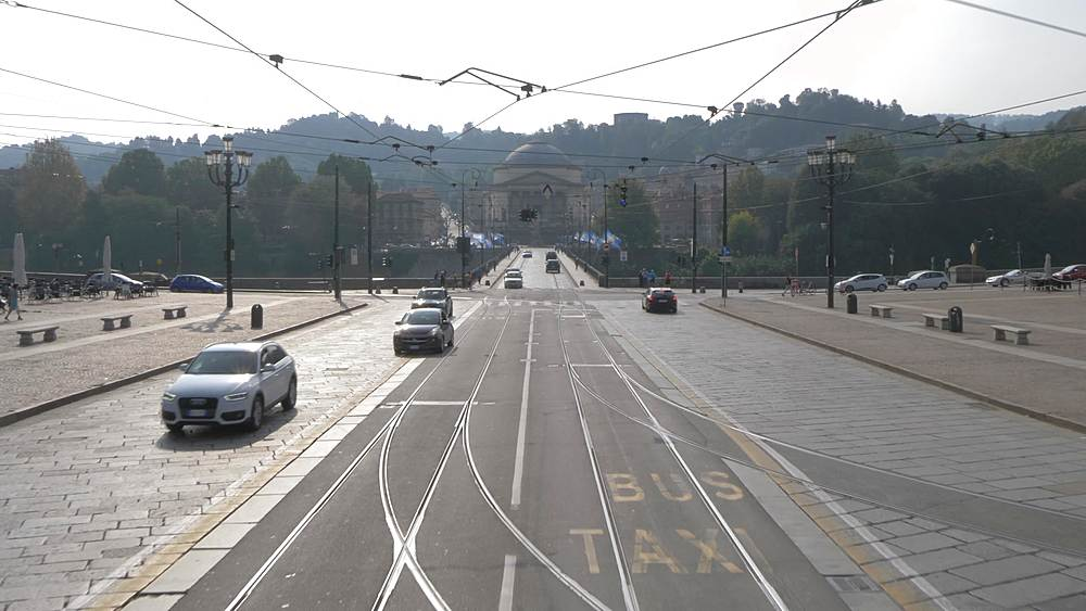 Elevated tracking view of Via Po from open top bus and Piazza Vittorio Veneto, Turin, Piedmont, Italy, Europe