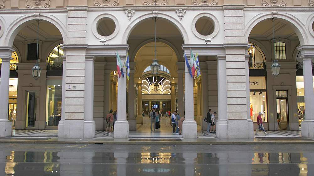 Zoom out shot of entrance to Galleria San Federico on Via Roma, Turin, Piedmont, Italy, Europe