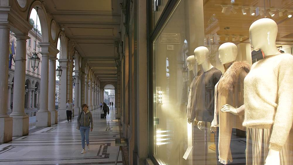 Pan shot of fashion shops and shoppers on Via Roma, Turin, Piedmont, Italy, Europe