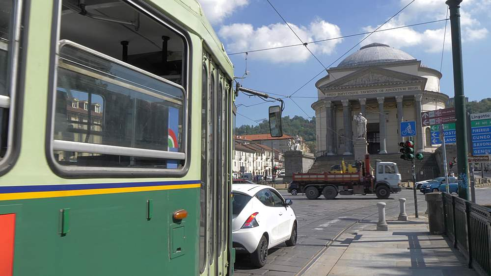 Tracking shot of tram in Piazza Vittorio Veneto with Gran Madre Di Dio Church in background, Turin, Piedmont, Italy, Europe
