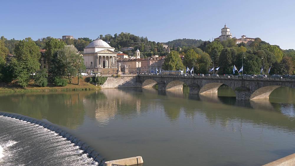 Pan shot of River Po towards Gran Madre Di Dio Church and Santa Maria del Monte dei Cappuccini, Turin, Piedmont, Italy, Europe