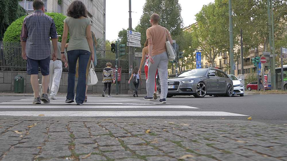 Tracking shot of people on Corso Vittorio Emanuele ll during summer, Turin, Piedmont, Italy, Europe