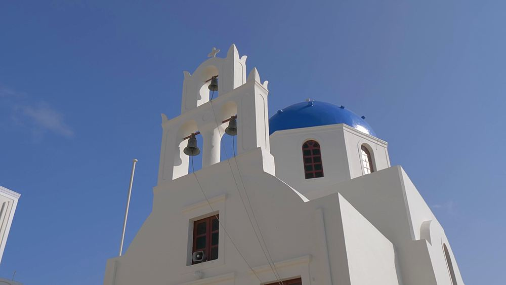 Crane shot of blue domed chapel in Oia, Santorini, Cyclades, Greek Islands, Greece, Europe
