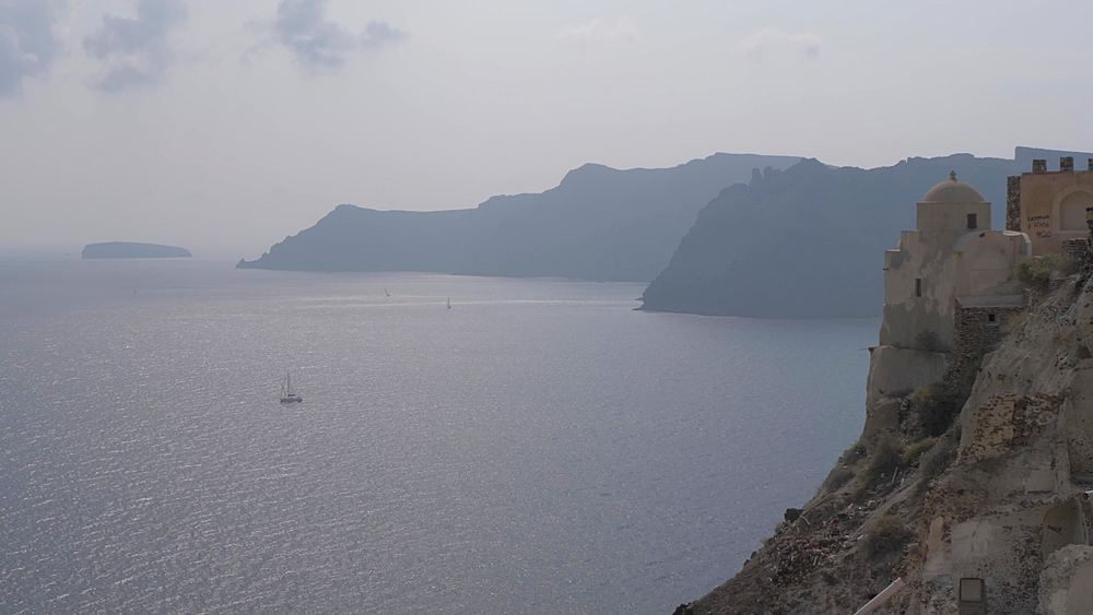 Still view of boats in the Med Sea near Oia, Santorini, Cyclades, Greek Islands, Greece, Europe