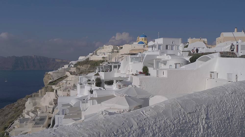 Slider shot of white washed houses in Oia, Santorini, Cyclades, Greek Islands, Greece, Europe
