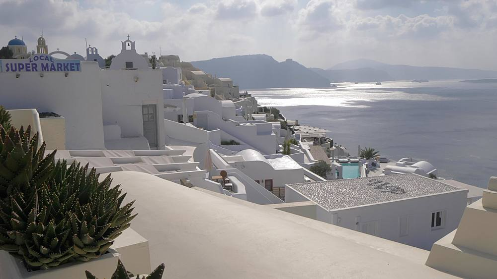 Slider shot of white washed village of Oia, Santorini, Cyclades, Greek Islands, Greece, Europe